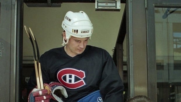 Montreal Canadiens' Todd Ewen signs an autograph for a fan at the Forum in Montreal, May 27, 1993. THE CANADIAN PRESS/Ryan Remiorz