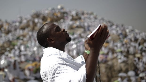 A Muslim pilgrim prays on Mount Mercy on the plains of Arafat during the annual hajj pilgrimage, outside the holy city of Mecca Wednesday.