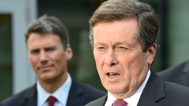 Toronto Mayor John Tory, right, offered to help Vancouver's Mayor Gregor Robertson, left, during that city's fentanyl crisis. Instead, he was given a stark warning.