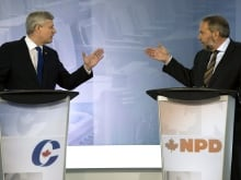 Liberal Leader Justin Trudeau, left, Conservative Leader Stephen Harper, centre, and New Democratic Party Leader Tom Mulcair, right, chat on stage at the Munk Debate on Canada's foreign policy in Toronto, on Tuesday, September 28, 2015.