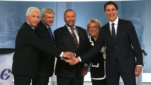 Bloc Quebecois Leader Gilles Duceppe, left to right, Conservative Leader and Prime Minister Stephen Harper, New Democratic Party Leader Thomas Mulcair, Green Party Leader Elizabeth May and Liberal Leader Justin Trudeau shake hands before the start of the French-language leaders' debate in Montreal on  September 24, 2015.