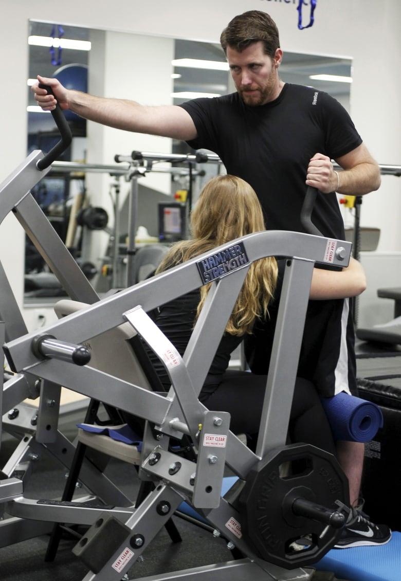 Paralyzed man walks again using brain-computer link | CBC News