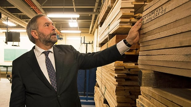 NDP Leader Tom Mulcair tours the mill at the forestry school in Sainte-Catherine-de-la-Jacques-Cartier on Friday. No problems with exporting lumber.