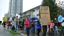 Residents rally against building demolitions
