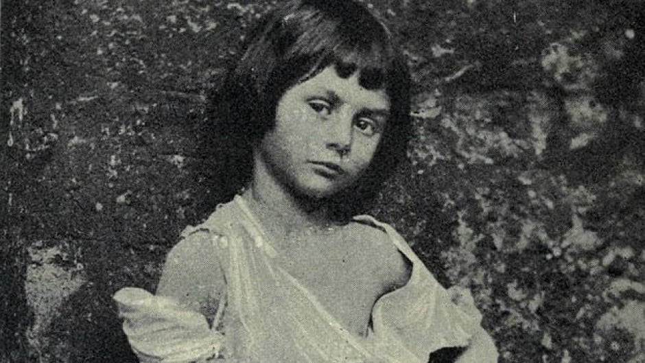 "Alice Liddell at age 6, posing as ""The Beggar Maid."" This photo, taken by Lewis Carroll, has given rise to speculation about the relationship between the Oxford don and the precocious little girl who inspired him to write ""Alice's Adventures in Wonderland."""