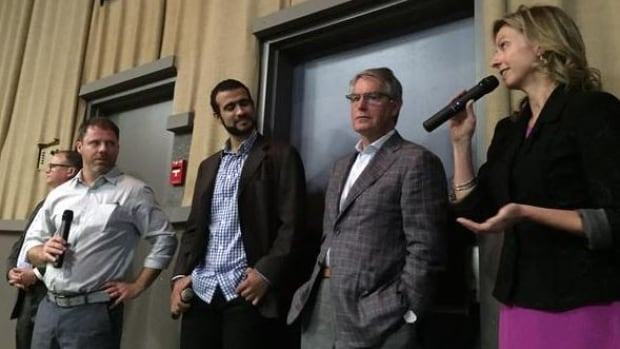 Omar Khadr, middle, answered questions from the audience after the screening in Calgary of a documentary about his life.