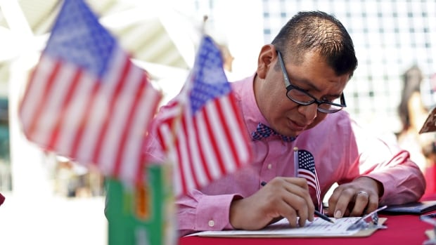 New U.S. citizen Hermilo Pablo registers to vote during a voter registration drive for National Voter Registration Day outside the Los Angeles Convention Center on Sept. 22, 2015.