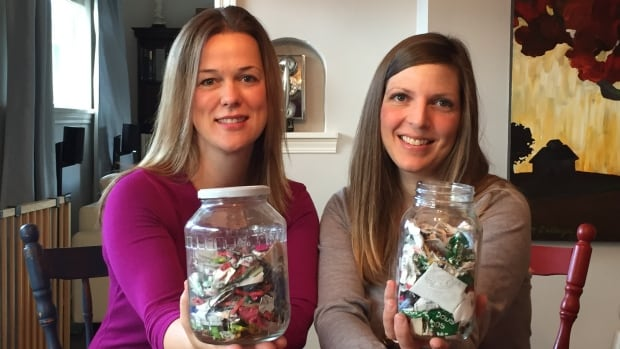 Katelin Leblond, left, and Tara Smith-Arnsdorf and their families produce such little trash now that they replaced their garbage cans with glass jars. Neither jar has been emptied since Earth Day on April 22, 2015.
