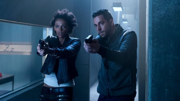 In this image released by NBC, Judith Shekoni portrays Joanne Collins, left, and Zachary Levi portrays Luke Collins in a scene from Heroes Reborn. The series, a reboot of Heroes, is filming at Kitchener City Hall this week.