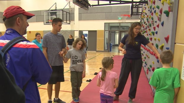 Visually impaired kids learn how to rock climb with Manitoba Blind Sports Association on Sunday at the University of Winnipeg.