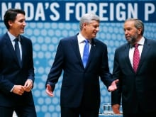 Liberal leader Justin Trudeau, Conservative leader and Prime Minister Stephen Harper and New Democratic Party (NDP) leader Thomas Mulcair (L-R) talk before the Munk leaders' debate on Canada's foreign policy in Toronto.