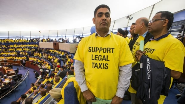 Taxi driver Sajjad Ahmad attends the city council to protest Uber, in Toronto, September 30, 2015.