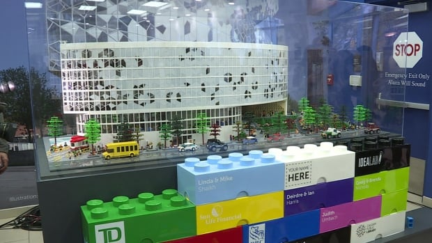 A wall of giant Lego bricks in front of a new Lego model of the new Calgary Central Library represent contributions to the foundation's Add In campaign.