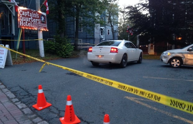 Police at Captain's Quarters Hotel after fatal shooting armed robbery St. John's