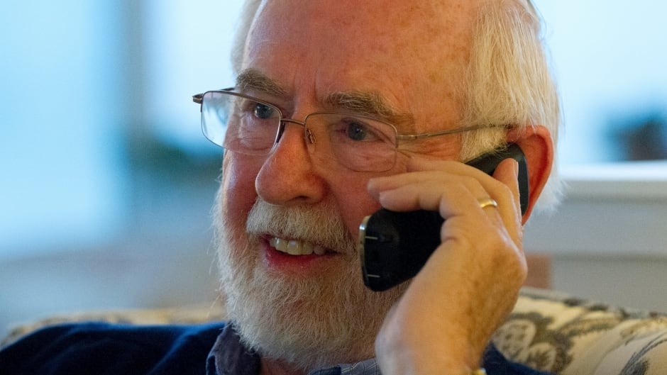 Arthur B. MacDonald, professor Emeritus at Queen's University in Canada, speaks on the phone shortly after learning that he was a co-winner of the Nobel Prize for Physics at his home in Kingston, Ontario October 6, 2015. Japan's Takaaki Kajita and Canada's Arthur B. McDonald won the 2015 Nobel Prize for Physics for their discovery that neutrinos, labeled nature's most elusive particles, have mass, the award-giving body said on Tuesday.