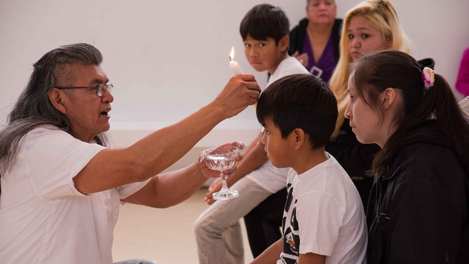 Eugene Harry baptizes three children including twin boys at a Shaker ceremony in West Vancouver