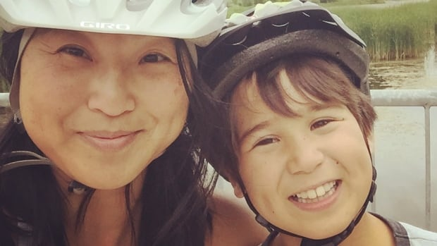 CBC Ottawa reporter Judy Trinh, left, gave her son Matthew, right, hope with her journey to Canada as one of the Vietnamese boat people, according to homework written by Matthew.