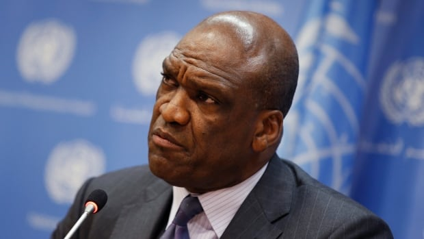 Former UN General Assembly president John Ashe faces faces tax fraud charges along with five others in an alleged bribery scheme.