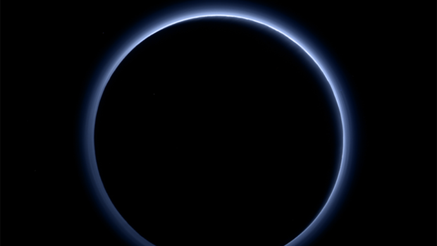 The blue halo of Pluto's atmospheric haze stands out in the newest colour photos sent home by the New Horizons spacecraft.
