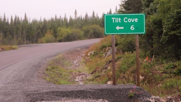 The sign on the main road points to Tilt Cove. Today, the distance and the population are the same number.