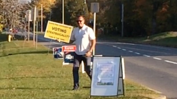 A Kanata resident says he saw this man in a white truck taking down yellow signs asking Kanata-Carleton residents to vote strategically on Sunday. Monday, the riding's Conservative candidate Walter Pamic apologized for doing that, saying he's talked to the city's bylaw department and learned he should have left it to them.