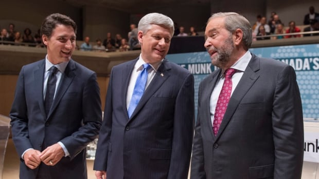 Liberal Leader Justin Trudeau, Conservative Leader Stephen Harper and NDP Leader Tom Mulcair chat prior to the Munk debate in late September. The leaders' focus on the refugee crisis and the niqab are reflected in the top trending election issues on Google.