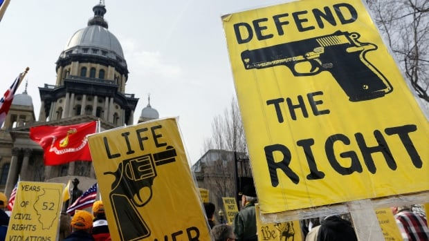 Gun rights lobbyists and gun owners rallied in support of concealed carry gun legislation last year in Springfield, Ill. Gun rights groups and the gay rights community have more in common than one might think, according to some advocates in the U.S.