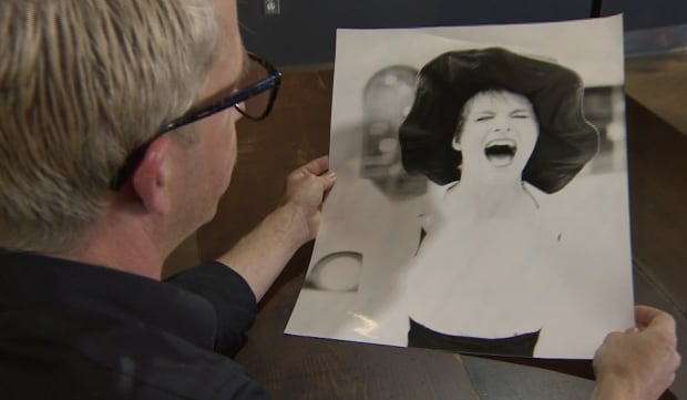 Fred Connors looks at the photo he took of Loresa Makonin 25 years ago.