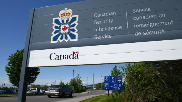 A sign for the Canadian Security Intelligence Service building is shown in Ottawa, Tuesday, May 14, 2013. Newly released memos show Canada's spy agency revealed its interest in people to foreign partners in two cases after receiving assurances the individuals would not be tortured, a practice human rights advocates say shirks the law and puts vulnerable detainees at risk.