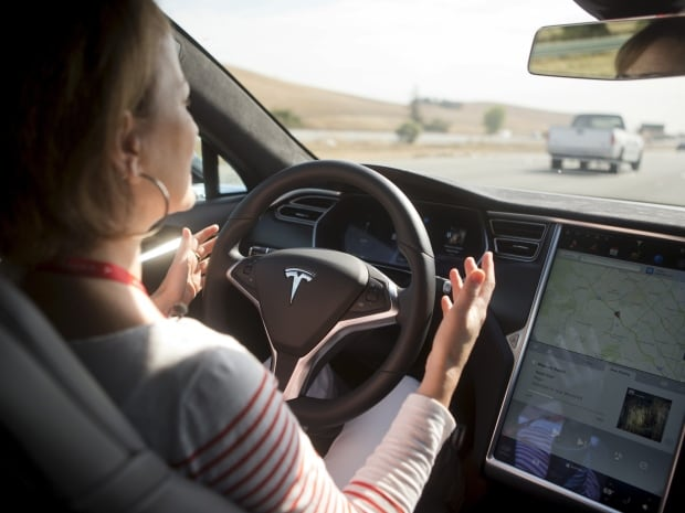 Tesla Autopilot software will let some cars drive park and change