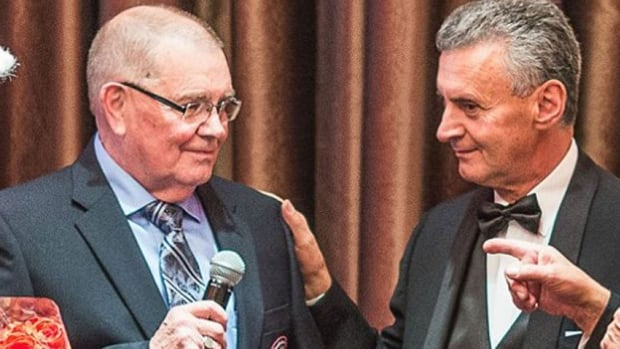 Barrie Poole (left) is inducted into the Canadian Drag Racing Hall of Fame.