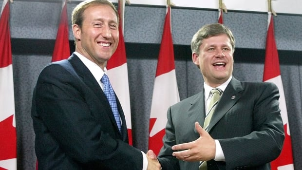 In October 2003, Progressive Conservative leader Peter MacKay shakes hands with Canadian Alliance leader Stephen Harper after their announcement of a