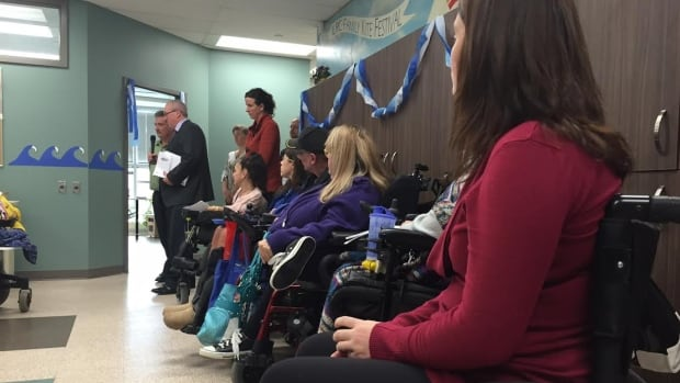 Dozens of Handi Transit users gather at the Independent Living Resource Centre on Thursday to discuss a complaint that will be filed to the Manitoba Ombudsman's office regarding the transit service.