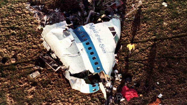 In this Dec. 22, 1988 photo the nose section of Pan Am Flight 103, a 747 airliner, lies in a field outside the village of Lockerbie, Scotland.