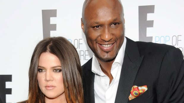 Khloe Kardashian, seen in 2012 with estranged husband Lamar Odom, says putting their divorce on hold was smarter 'for medical decisions and a ton of other things... But that does not mean I'm back with Lamar. It's not even in our brains to think about us having a relationship. Only time will tell.'