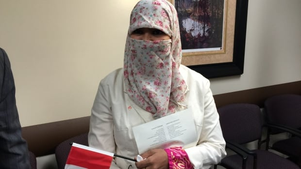 New Canadian Zunere Ishaq, 29, attends her citizenship ceremony on Oct. 10. A new report shows former prime minister Stephen Harper spent more than twice his budget in the run-up to the Oct. 19 election on taxpayer-funded surveys, including polls asking Canadians about the niqab at citizenship ceremonies.