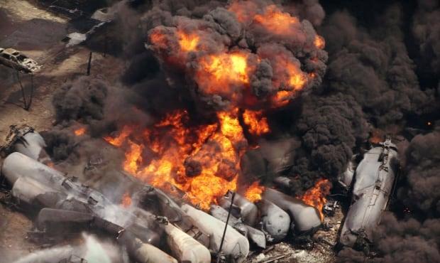 Smoke rises from railway cars - LacMégantic
