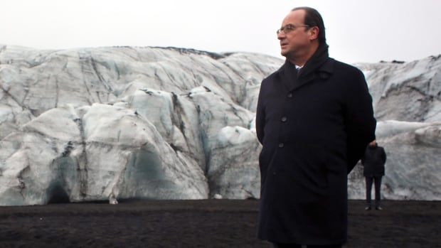France's President Francois Hollande walks on the Solheimajokull glacier, where the ice has retreated by more than 1 km during a State visit in Iceland on Friday.
