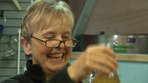 Lynne MacKay prepares for a gin-brewing workshop at Ironworks Distillery in Lunenburg, N.S.