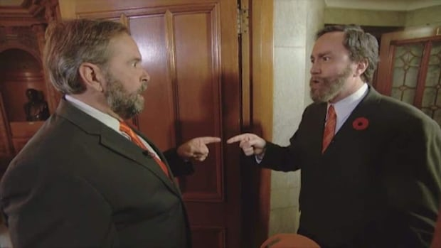 NDP Leader Tom Mulcair reacts to 22 Minutes' Mark Critch dressed as Tom Mulcair, in a 2014 sketch. Critch says he's learned a lot by poking fun at the people who will be judged by voters on Monday.