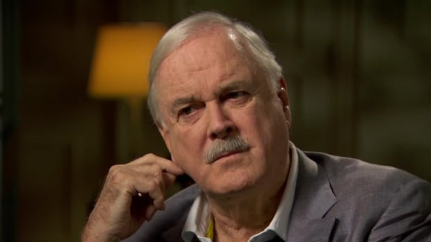 Comedian John Cleese, seen here in a 2014 interview with CBC News, once called Canada the 'sanest nation there is.'