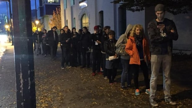 Voters in Vancouver lined up to vote minutes before polls closed in British Columbia.