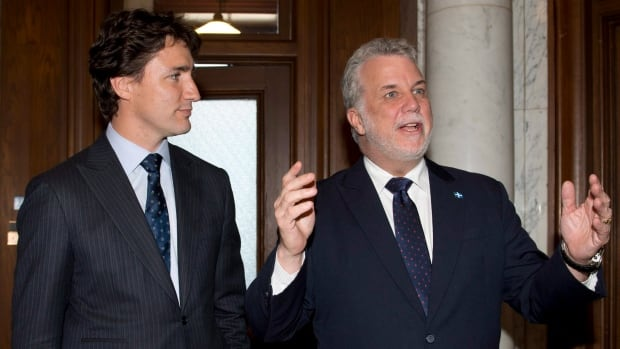 Federal Liberal Leader Justin Trudeau, left, looks at Quebec Premier Philippe Couillard as they meet at the premier's office in Quebec City in May 2014.