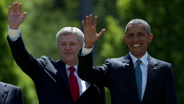 Prime Minister Stephen Harper and U.S. President Barack Obama wave during the G7 summit in Germany in June. The White House reacted to Monday's election results by offering congratulations to Justin Trudeau for winning and saying the U.S. appreciates Harper's efforts on the bilateral relationship.