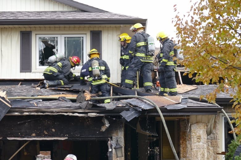 Crews Climbed Onto The Garage Roof To Better Access The
