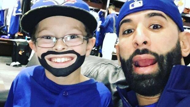 Oscar Wood, 9, aka 'Mini Bautista' meets Jose Bautista ahead of game four of ALCS.