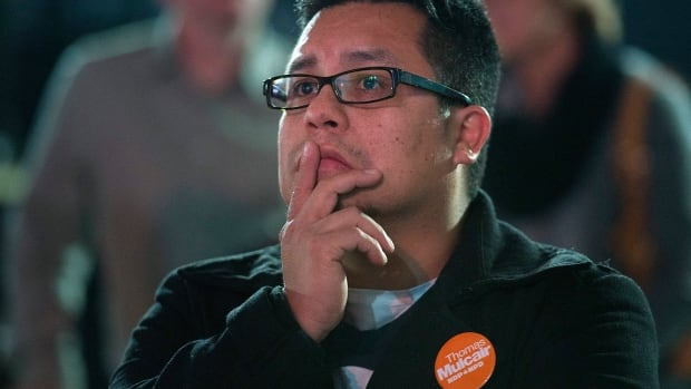 An NDP supporter looks on as results come in at the NDP federal election night headquarters in Montreal on Monday.