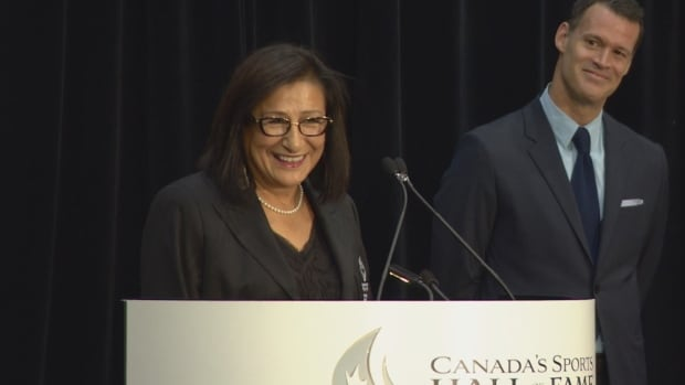 Sharon Firth accepts her induction into Canada's Sports Hall of Fame Tuesday. Firth also accepted the induction on behalf of her late twin sister Shirley Firth-Larsson.