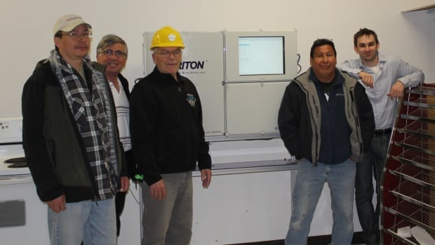 The Safe Water project provides the technology and support to respond to drinking water issues immediately. Photo: Barry Strachan (third from left), Johnny Miles, Dennis Big George, and Eric Morris inside water plant in Fort Severn.
