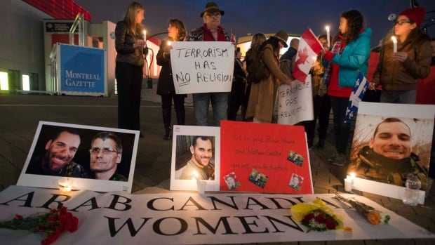 Mourners take part in a vigil for slain soldiers Cpl. Nathan Cirillo and Warrant Officer Patrice Vincent on Oct. 28, 2014, in Montreal. Muslim Canadians were quick to denounce the attacks on Cirillo and Vincent after it emerged that the perpetrators were both Muslim converts who were inspired by ISIS propaganda.